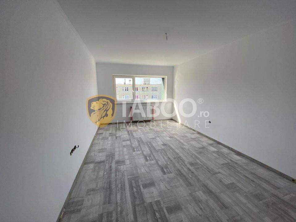 Apartament 3 camere etaj 2 decomandat total in Cisnadie zona centrala 1