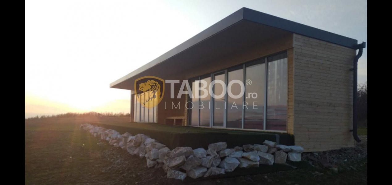 Casa de vacanta cu teren de 11.500 mp in Bungard judetul Sibiu 1